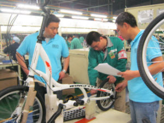 Auditors checking bicycle parts