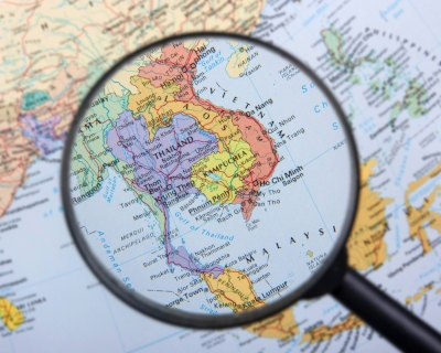 magnifying glass over Asia